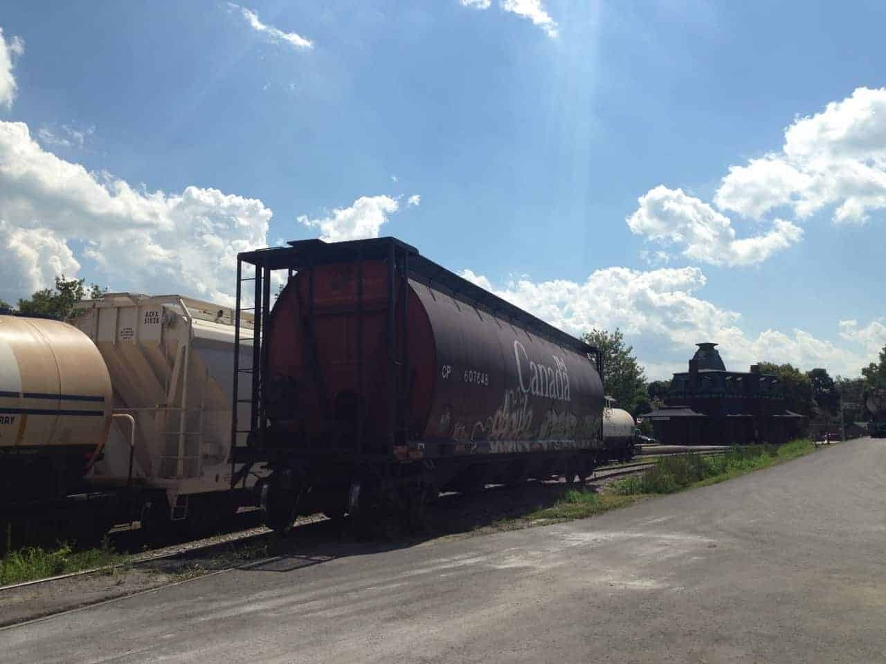 A freight train waits by Whitman's Feed Store in North bennington, Vt. Photo by Kate Abbott