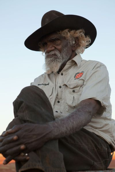 Indigenous elder Nyarri Morgan of the Martu tribe in the remote Western Australian Pilbara desert reflects on his first contact with Western culture, in Australian artist and filmmaker Lynette Wallworth's Collisions. Photo by Piers Mussared, courtesy of Lynette Wallworth.