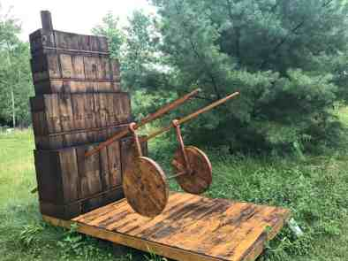 Wood sculptures in the summer show include a tipsy wheelbarrow. Photo by Kate Abbott