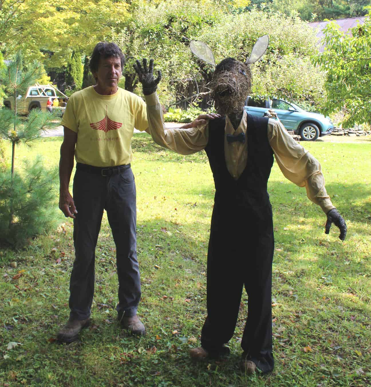 Nick Bottom, left, a character in Shakespeare's A Midsummer Night's Dream, stands in Plainfield (hint) beside Sculptor Michael Melle, who created these hay animals, human and domestic. Photo by Thom Smith