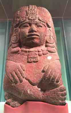 An Aztec fertility goddess looks down from a pillar at the center of Seeds of Divinity at WCMA. On load from the Worceser Art Museum. Photo by Kate Abbott