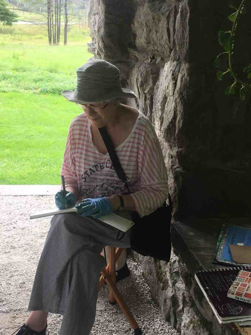 A plein air painter from the Guild of Berkshire Artists captures an outdoor scene at The Mount in Lenox.