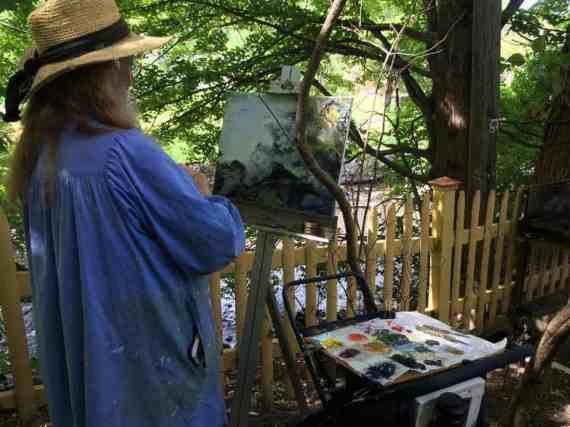 A plein air painter from the Guild of Berkshire Artists captures an outdoor scene.