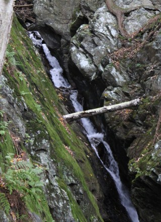 In a usual fall, this cascade often has very little water. the frequent storms have kept it flowing. Photo by Thom Smith, courtesy of the artist