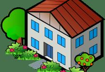 dorpshuis gebouw met rood dak en blauwe ramen met bomen ernaast