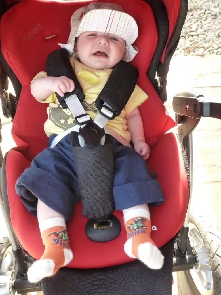 crying baby in pushchair