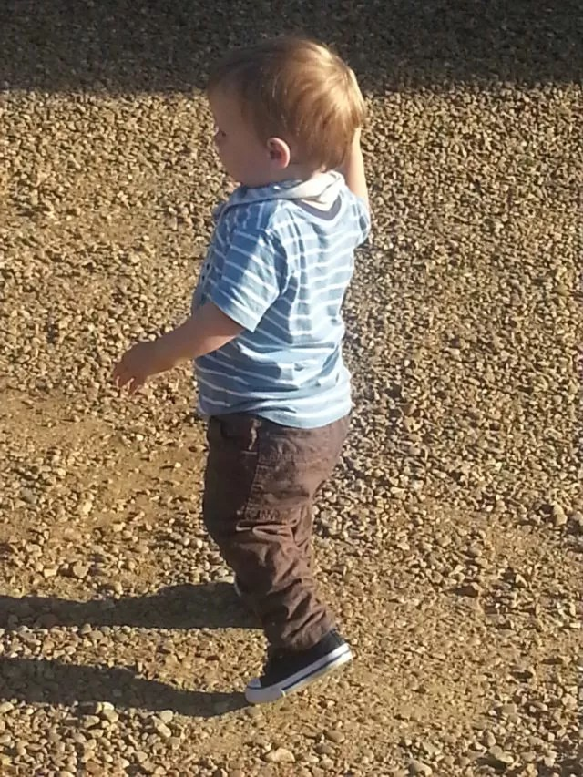toddler in winter trousers in summer