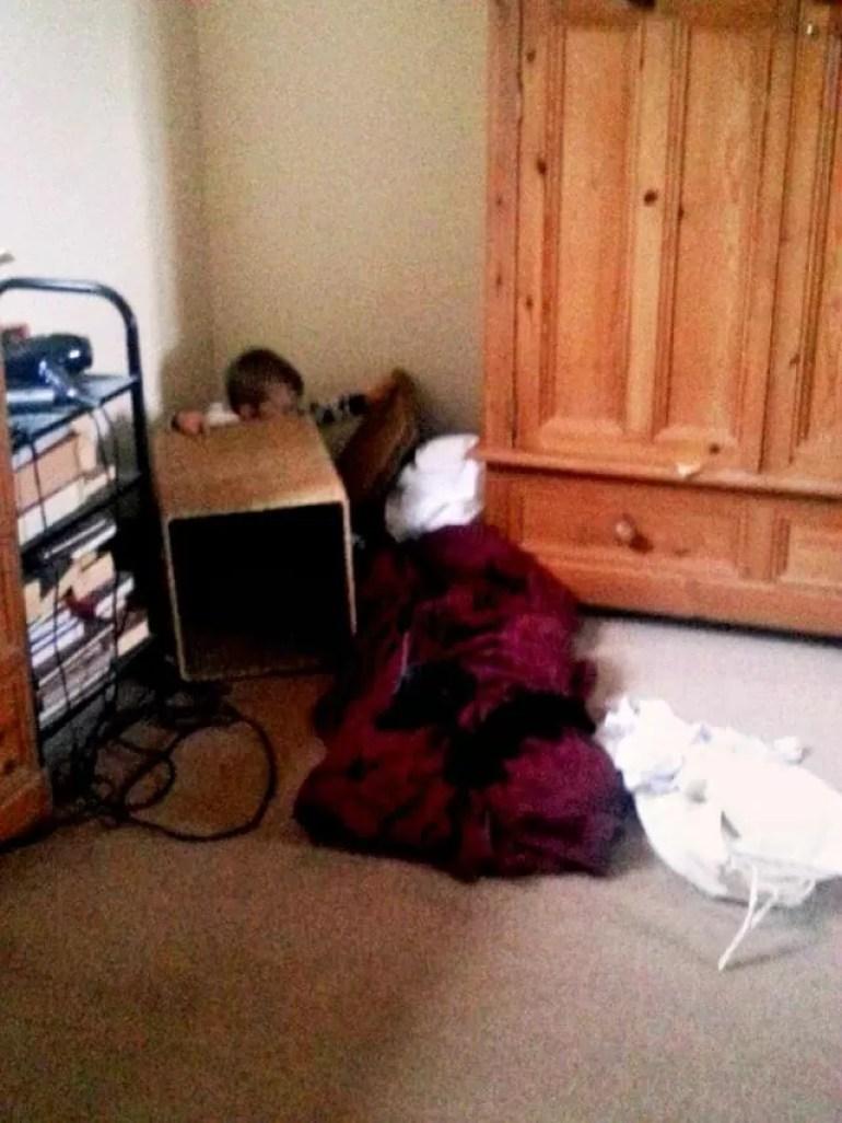 hiding behind furniture