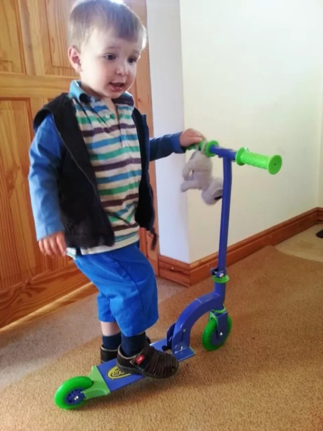 practising scooter riding in the house