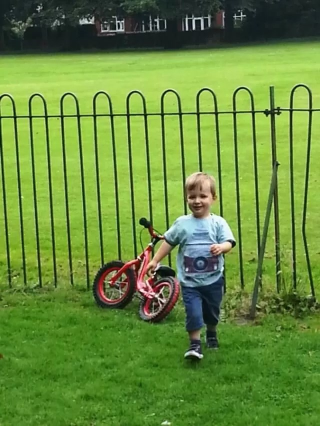 striding from his bike
