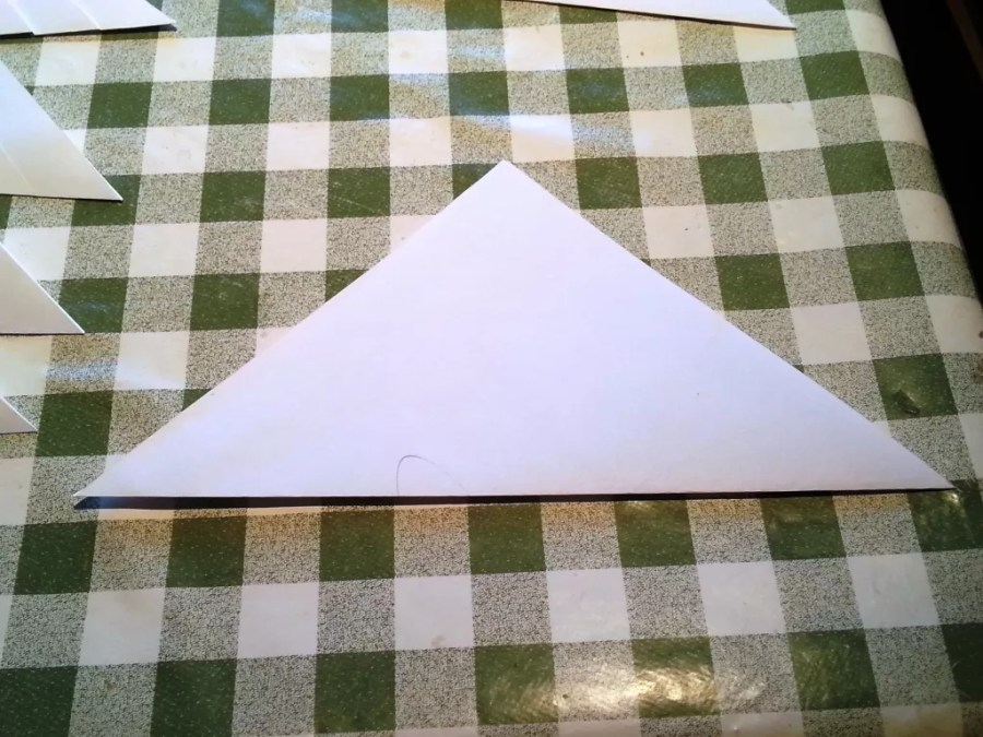 paper folded into a triangle