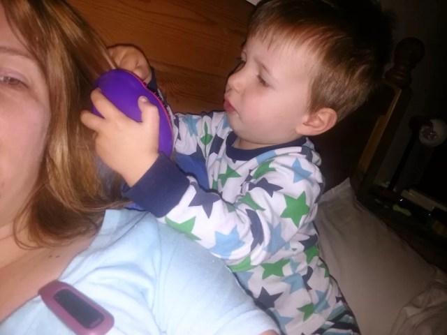 toddler hair brushing