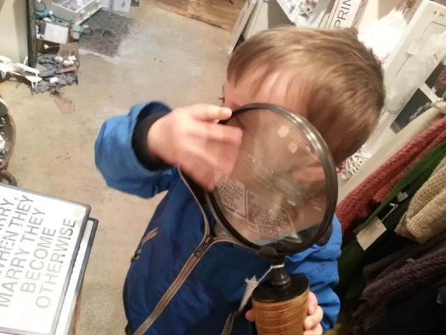 magnifying glass and toddler