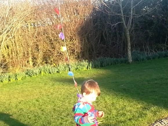toddler walking his kite
