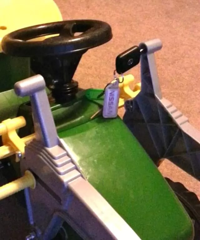 keys being used with toy tractor