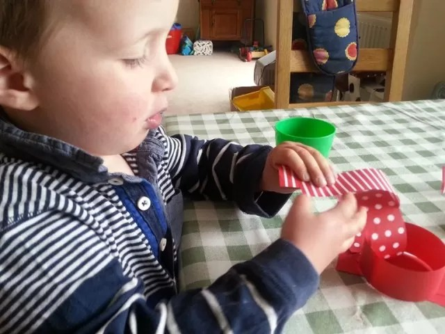 toddler making paper chains