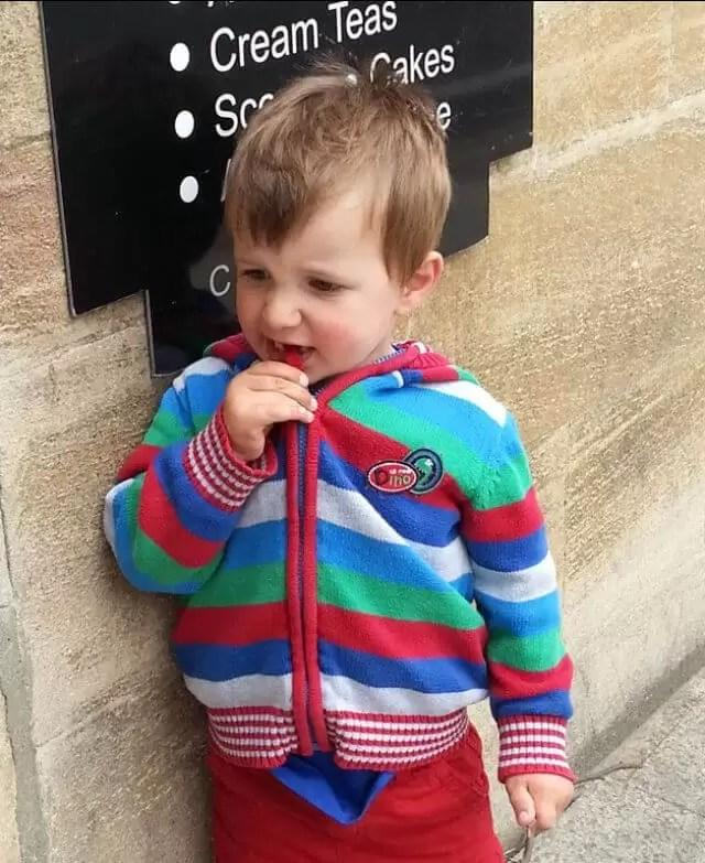 toddler in stripy hoody