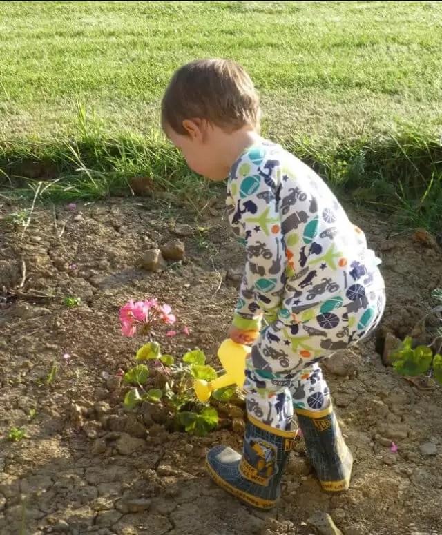 watering flowers in pjs