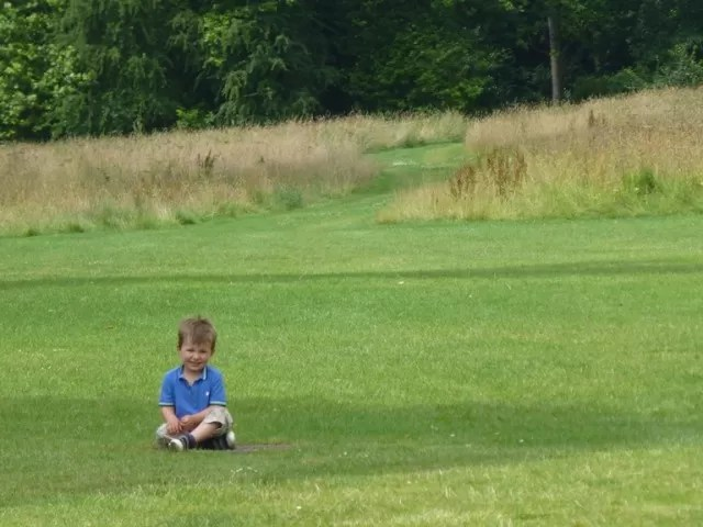 sitting on grass at compton verney