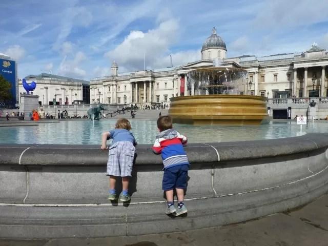 Trafalgar square fountains and boys