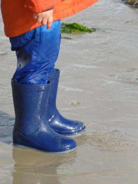 welly wet from waves at the seaside
