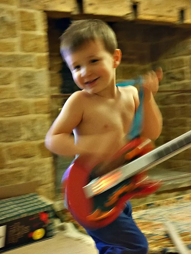 playing the toy guitair
