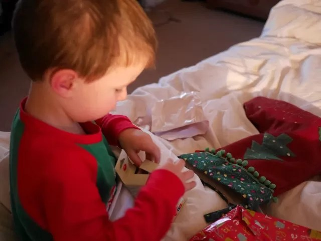 Opening his stocking on christmas day