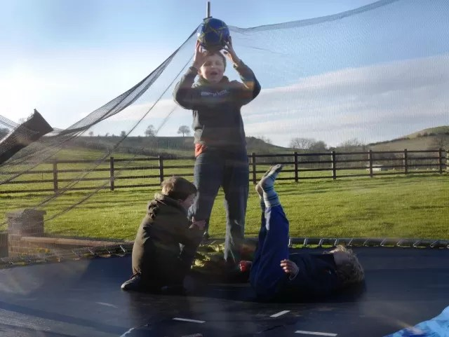 playing ball on a trampoline