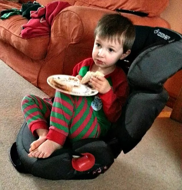 using a car seat as a chair for breakfast