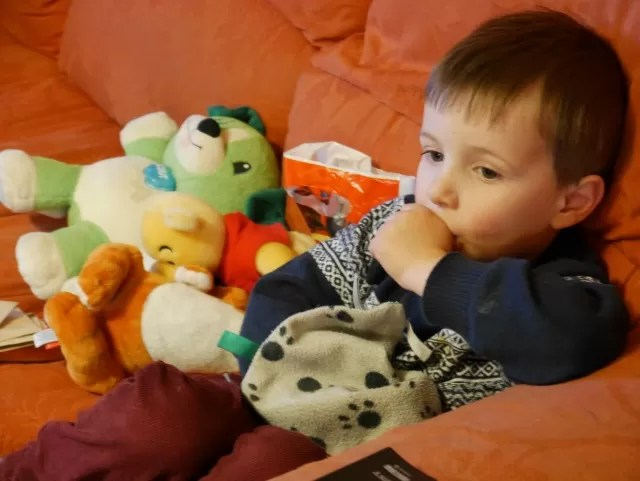 chilling with his teddies