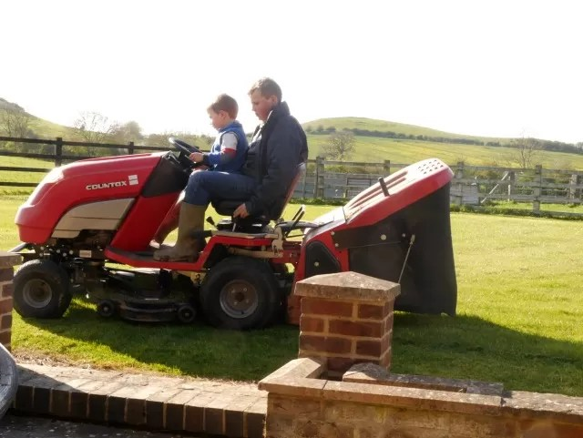 riding on the lawnmover