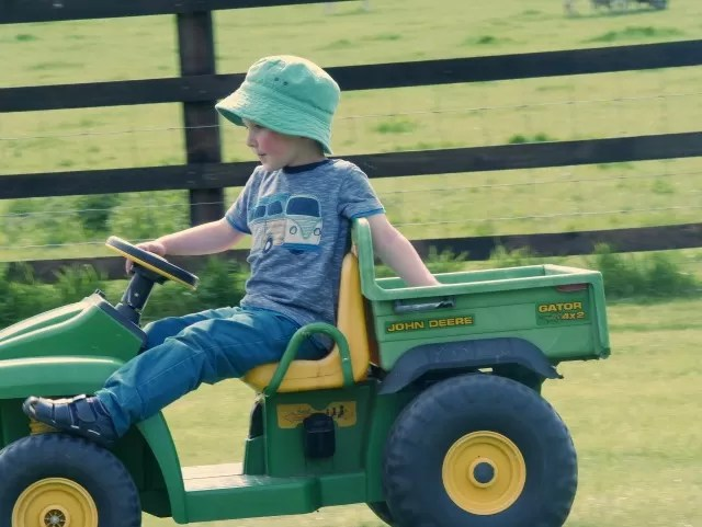 relaxed riding his John Deere Gator