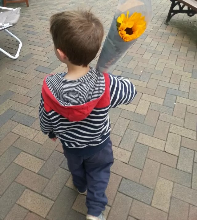 buying his first flowers