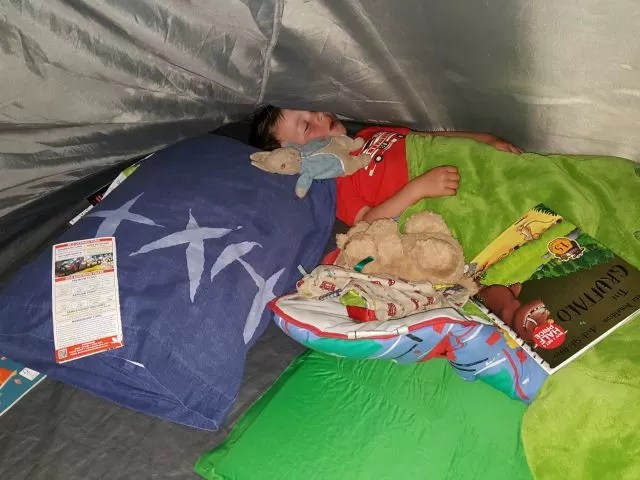 asleep in a tent