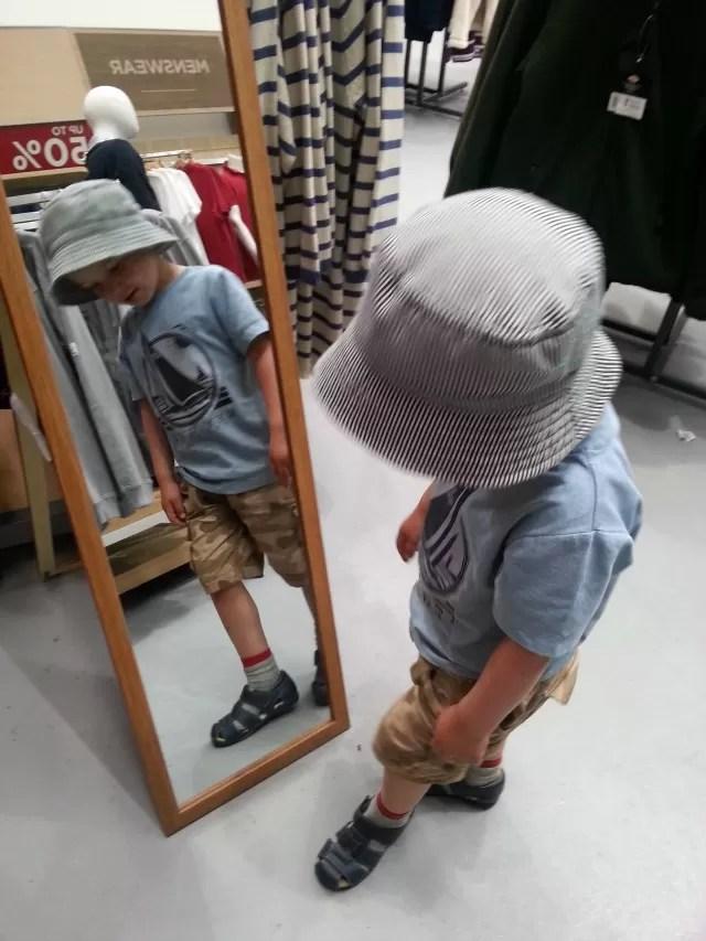 admiring himself in the mirror