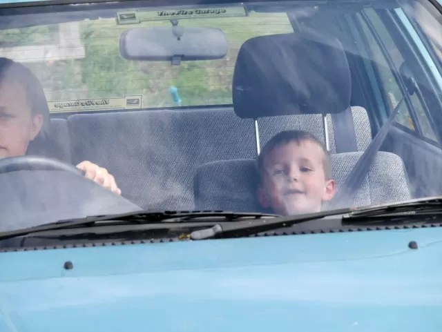 driving cars on the farm
