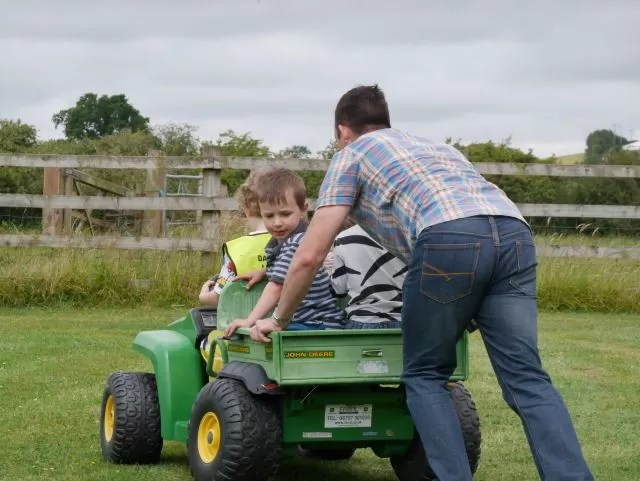 getting the adults to push them round on the gator