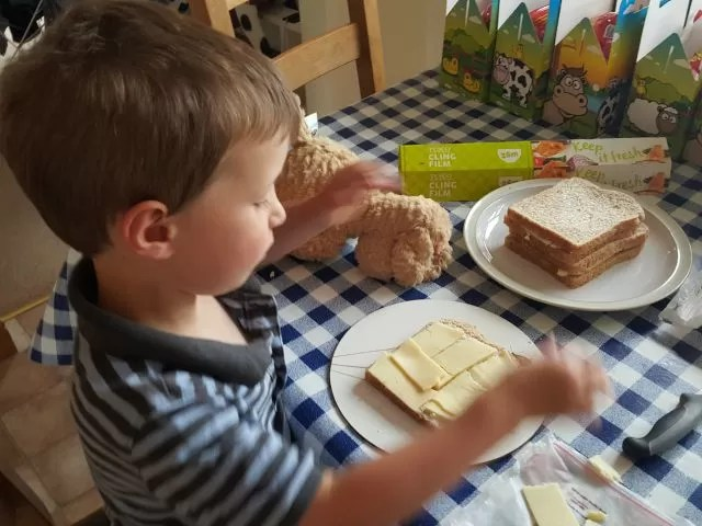 making sandwiches for his party
