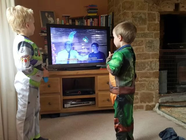 watching tv dressed as buzz lightyear and TMNT
