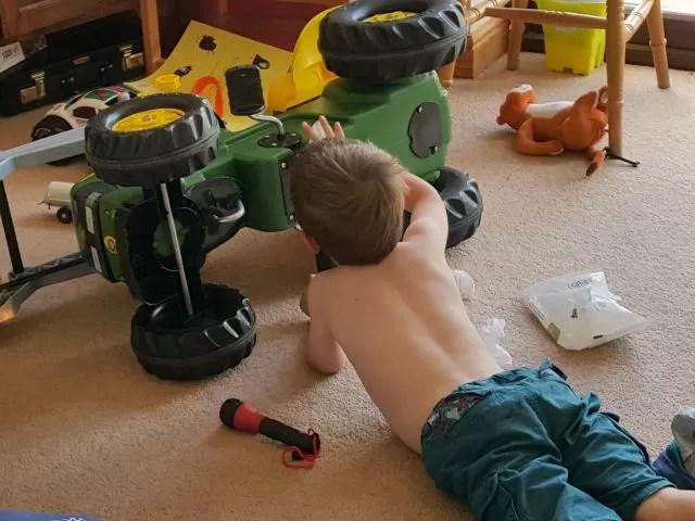 fixing his John Deere tractor
