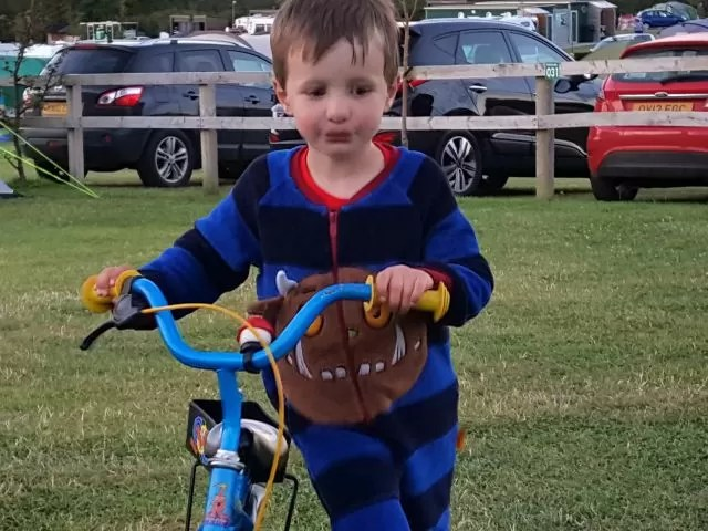 Hanging out in his Gruffalo onesie and bike