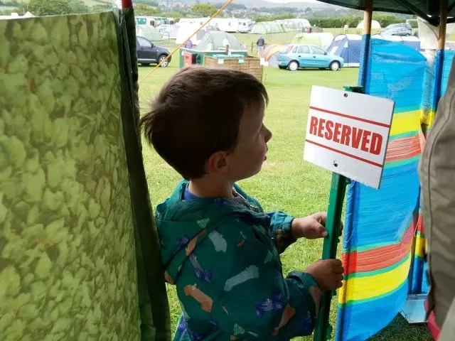 Under the gazebo with his favourite reserved sign