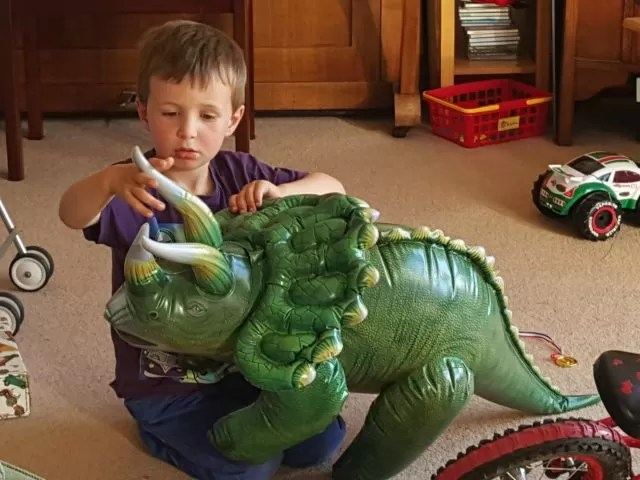 playing with the inflatable dinosaur