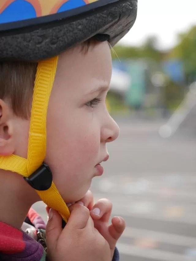 putting on his bike helmet