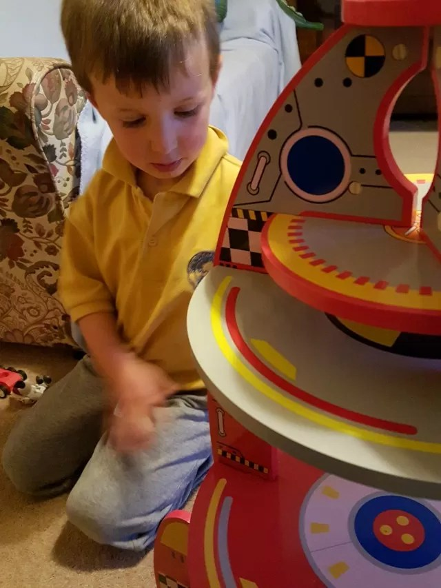 Asda wooden rocket toy
