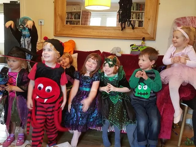 The gang in halloween costumes - 4 year olds and siblings