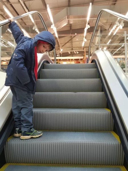 riding the escalator in Marks and Spencer