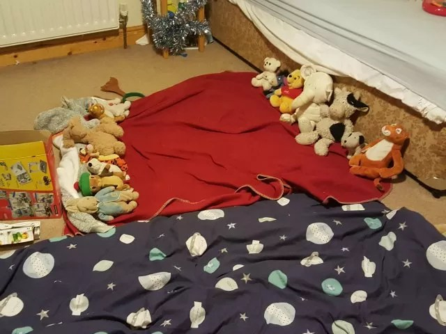 teddies lined up under blankets and duvets