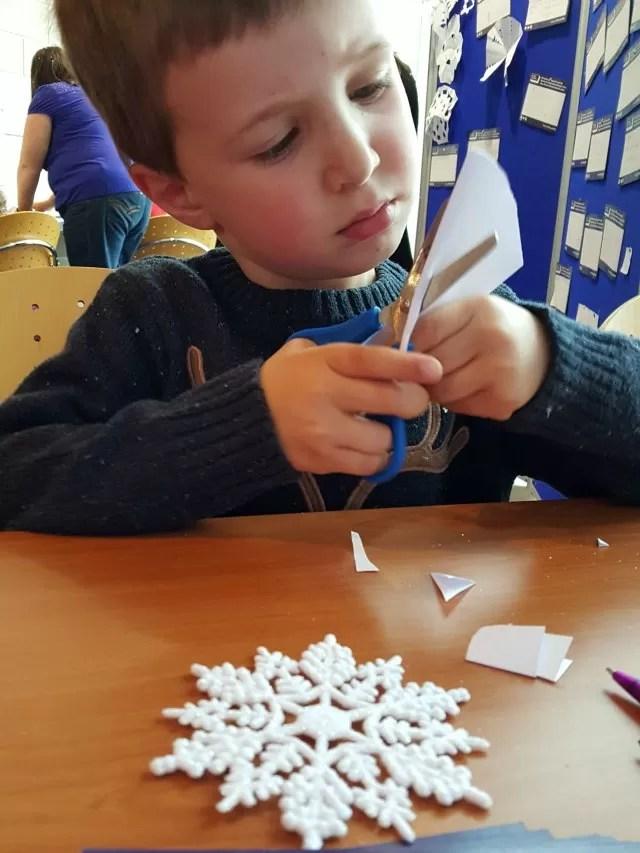 making paper snowflakes at Warwick Arts Centre
