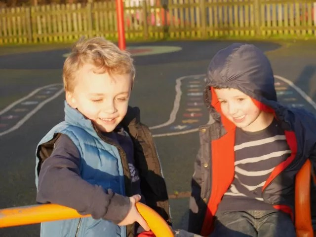 cousins playing together in the park